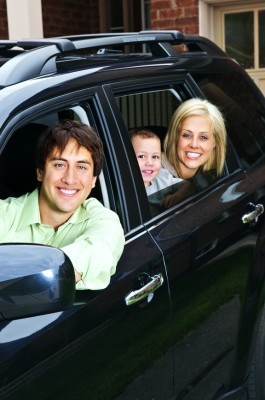 Happy family in car - Man, wife and son